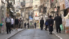 Street scene of ultra Orthodox Jewish neighborhood in Jerusalem, Israel Stock Footage