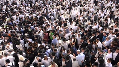 Overhead view of Jewish Orthodox men at the Western Wall in Jerusalem, Israel Stock Footage
