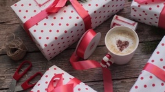 Holiday Gift Boxes and Coffee on a Wooden Table Stock Footage