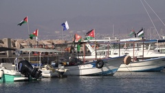 National Jordanian flags on top of ships in Aqaba Red Sea Stock Footage