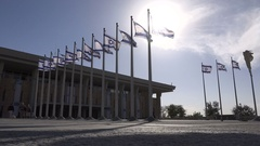 Low angle view of Israeli flags in front of the Knesset Stock Footage