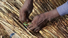 Detail of a thatched roof is being done by a professional. About architecture Stock Footage