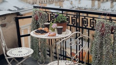 Breakfast Pastries With Tea and Grapes on the Balcony Overlooking the City Stock Footage