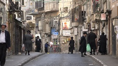 Street scene of an ultra Orthodox quarter (Mea Shearim) in Jerusalem, Israel Stock Footage