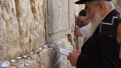 Closeup of a man reading the Torah at the Western Wall in Jerusalem, Israel Stock Footage