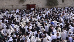 Jewish worshipers gather at the Western Wall in Jerusalem during Sukkot holiday Stock Footage