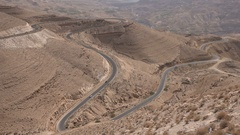Hairpins and curves at the King's Highway in Jordan, desert travel Middle East Stock Footage