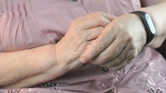The old woman using the wristband fitness tracker Stock Footage