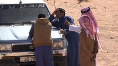 Jordanian tour guides wait for customers in Wadi Rum desert Stock Footage