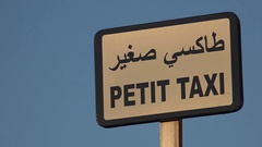 Sign for small taxis in French and Arabic in Morocco Stock Footage