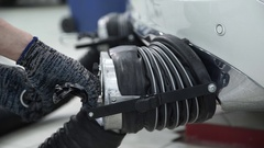 Mechanic wearing gloves disconnect the hood of vehicle exhaust gases Stock Footage
