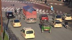 Tourist horse carriage among regular traffic at junction in Marrakesh, Morocco Stock Footage