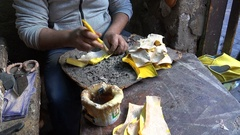 Artisan uses glue to make classic Moroccan slippers in Marrakesh bazaar Stock Footage