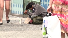 Homeless Man Receives Donation Stock Footage
