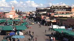 Panoramic restaurants at Djemaa el Fna square in Marrakesh, tourism Morocco Stock Footage