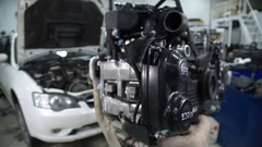 On foreground cars engine in professional cars centre indoors Stock Footage