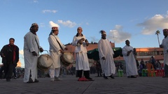 People dance and play music on tourist square Marrakesh Morocco Stock Footage