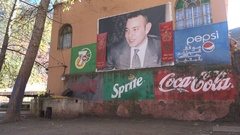 King of Morocco portrait, advertisements American multinationals Stock Footage