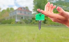 Hand with house key. Stock Photos
