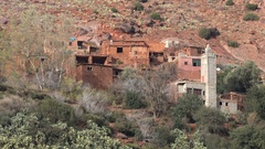 New mosque in old mud house, Berber village mountains Morocco Stock Footage
