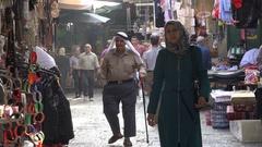 Veiled Muslim woman walk through streets Nablus bazaar, Palestinian Territories Stock Footage