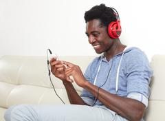 Afro-american man listening music. Stock Photos