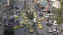 Traffic drives through downtown Nablus city, Palestinian Territories Stock Footage