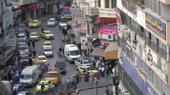 Slow driving traffic in main street in Nablus in the West Bank Stock Footage