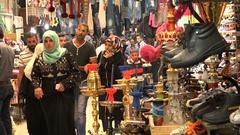 Tight shot of people walking through alleys of bazaar in Nablus, West Bank Stock Footage