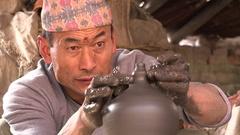 Focused pottery artist in workshop Nepal Asia Stock Footage