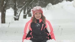 Slow motion of joyful child playing in snow. Happy girl having fun outside Stock Footage