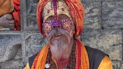 Nepali sadhu (holy man) smokes cannabis in a temple complex in Kathmandu Stock Footage