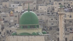 Heavy rain falls on green dome of a mosque in old city of Nablus West Bank Stock Footage