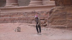 Worker cleaning site in Petra historic city in Jordan Stock Footage