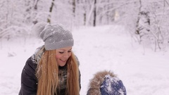 Family fun in a winter park. clouse-up. Stock Footage