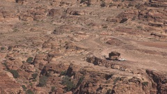 Car is parked in a dry mountain area in Southern Jordan in the Middle East Stock Footage