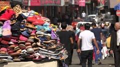 Shoe vendor in market bazaar, streets of Nablus city, West Bank Stock Footage