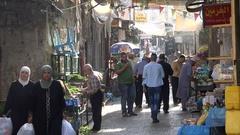 Busy market scene, people walk through bazaar Nablus city, West Bank Stock Footage
