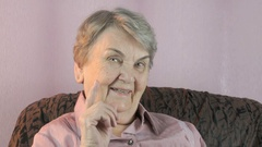 Old woman waves her index finger in front of face Stock Footage