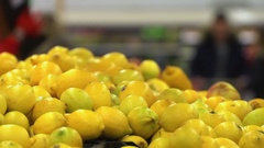 Concept healthy lifestyle and vegetarianism. Lemons closeup in supermarket Stock Footage