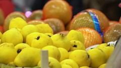 Concept healthy lifestyle and vegetarianism. Quince closeup in supermarket Stock Footage