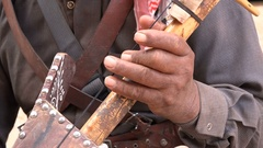 Closeup of a string instrument used by a Bedouin to play music in Jordan Stock Footage