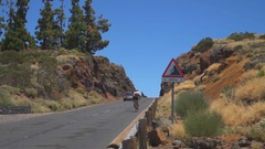 The car goes on the road to the mountain Stock Footage