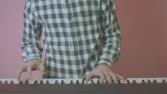 Close Up Of Young Guy Playing Piano Synth Cool Vintage Look Pink Background Stock Footage