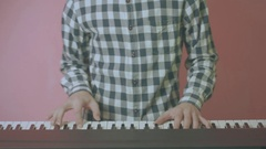 Close Up Of Young Handsome Guy Playing Piano Synth Vintage Look Stock Footage