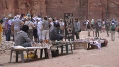 Jordanian vendors sell souvenirs to tourists visiting Petra Stock Footage