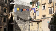 Line-Dried Colored Laundry Waving on the Rope. Stock Footage