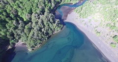Aerial drone scene of green river and lake in Patagonia, Volcanic sand. Stock Footage