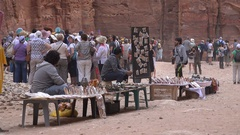 Vendors sell souvenirs, tour groups in Petra, Jordan Stock Footage