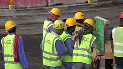 South Asian migrant workers at a construction site and new road in Doha, Qatar Stock Footage